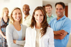 Portrait of confident multi racial business team smiling together